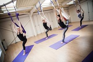 Sandra teaching aerial yoga
